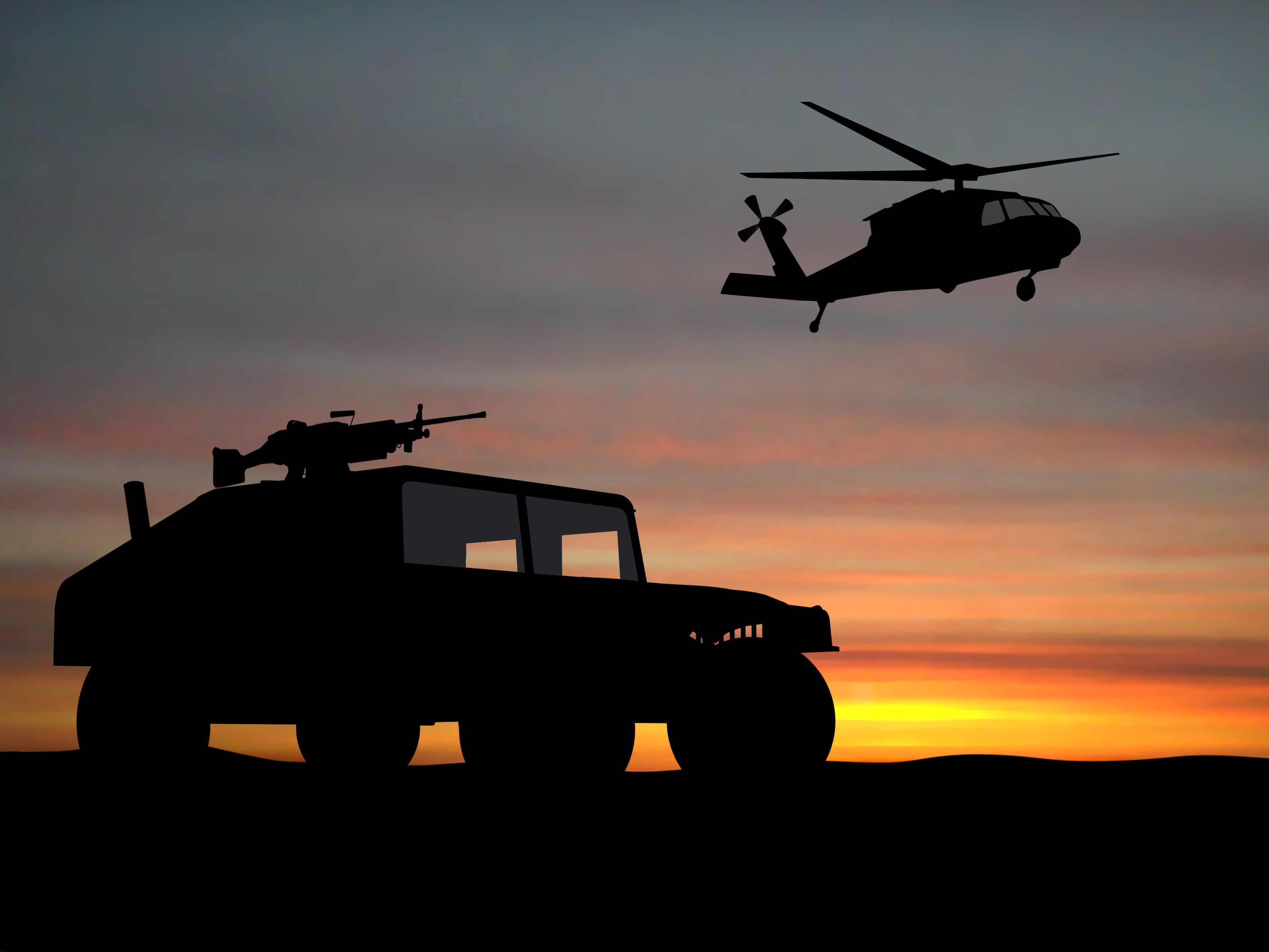 military vehicles over the sunset