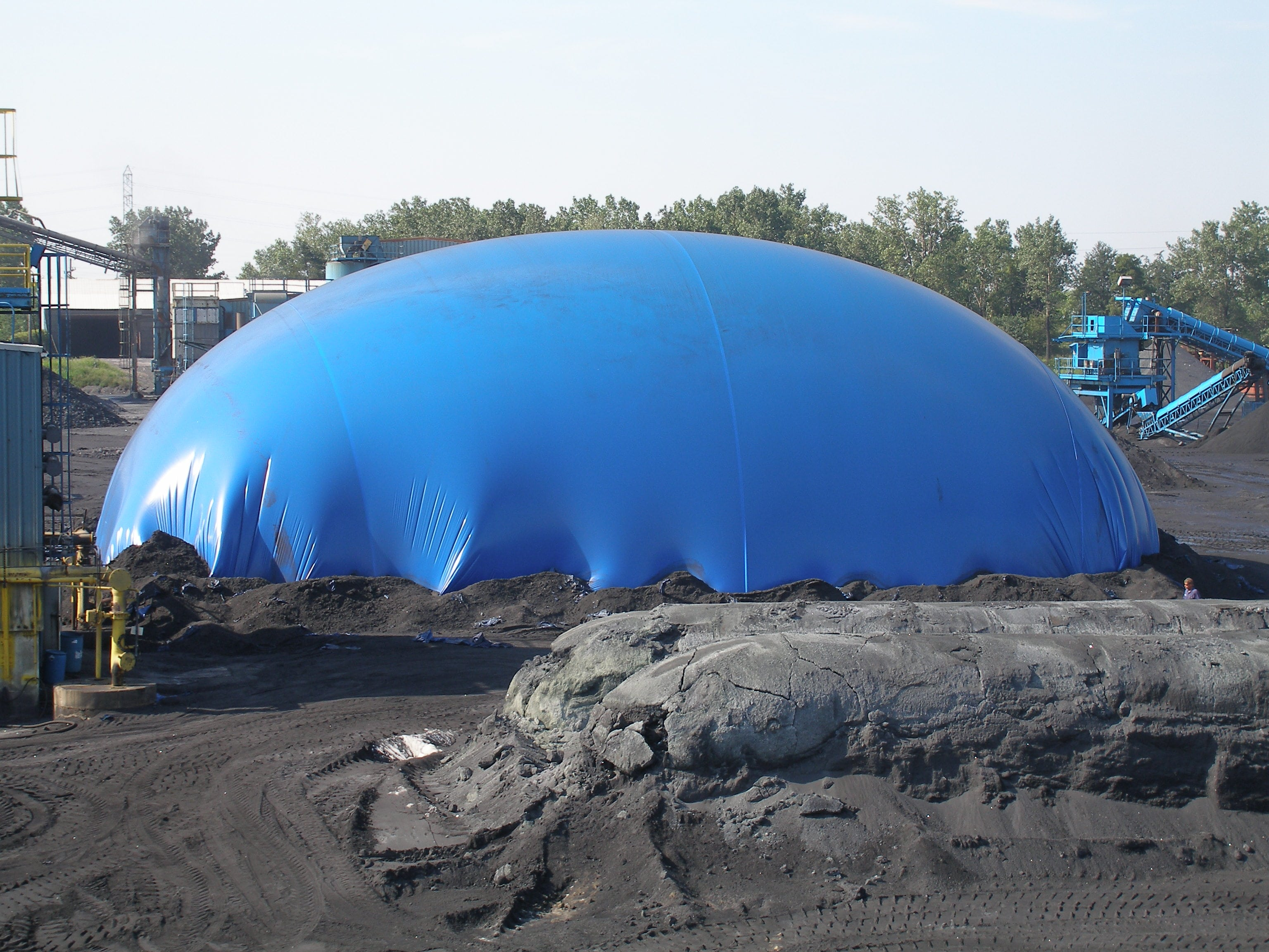 Hennepin silicon carbide furnace covered with blue tarp