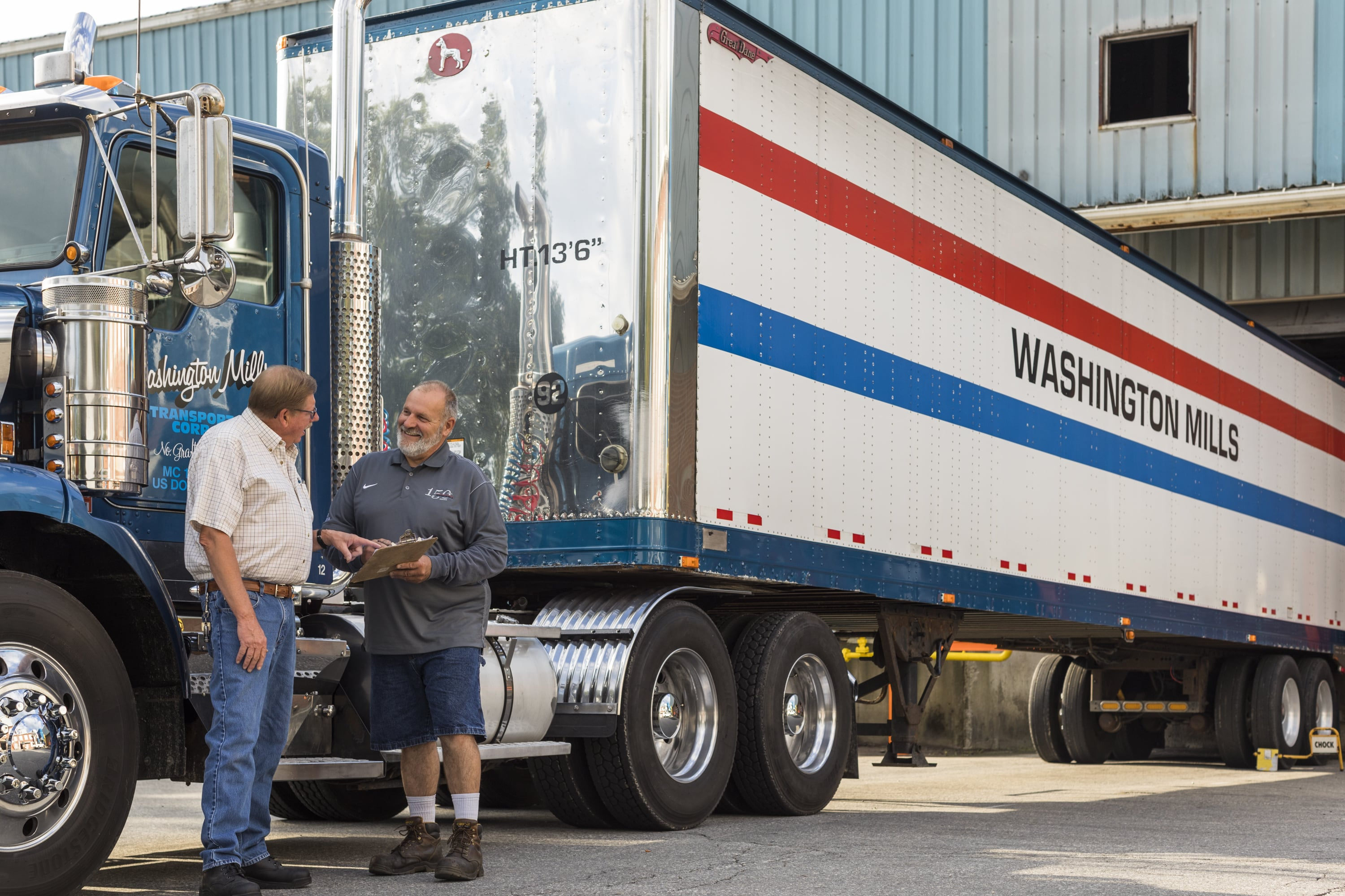 Bruce and Kenny talking at the Washington Mills truck